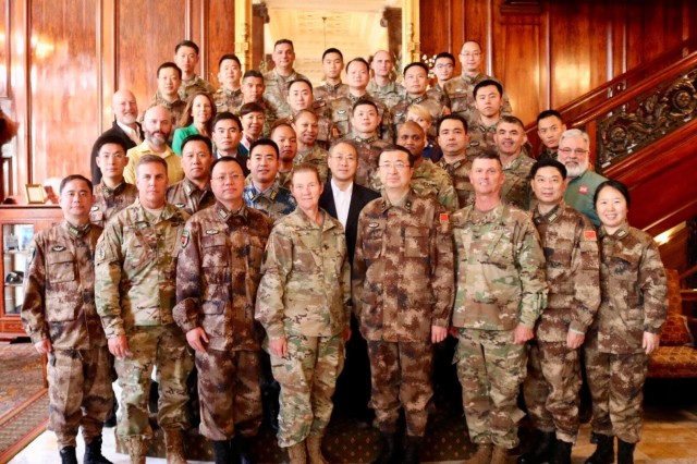 Participants from the Expert Academic Discussion portion of the 13th iteration of the U.S. -  China disaster management take a group photo before the event's conclusion in Portland, Ore, Nov 14.  The annual United States Army Pacific (USARPAC) Security Cooperation event with the People's Liberation Army (PLA) is an opportunity to share lessons learned between USARPAC and the PLA in order to increase capacity to respond to natural disasters in the Pacific region. Participants in this year's event included U.S. Army Pacific, the 8th Theater Sustainment Command, the Oregon National Guard, the U.S Coast Guard Sector Columbia River, the Center for Excellence in Disaster Management and Humanitarian Assistance, the U.S. Army Corps of Engineers Northwestern Division, the U.S. Army Corps of Engineers Portland District, the National Oceanic and Atmospheric Administration (NOAA), the United States Geological Survey (USGS) and the Pacific Disaster Center, an applied research center managed by the University of Hawaii. (U.S. Army