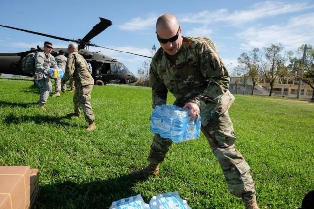A Soldier from the New York Army National Guard's 3rd Battalion 142nd Aviation unloads supplies from a UH-60 helicopter during a relief mission in Puerto Rico on Oct. 16, 2017.The 3rd Battalion 142nd Aviation has deployed 60 Army National Guard Soldiers and four UH-60 Black Hawk helicopters to Puerto Rico to assist in the island's recovery from Hurricane Maria.