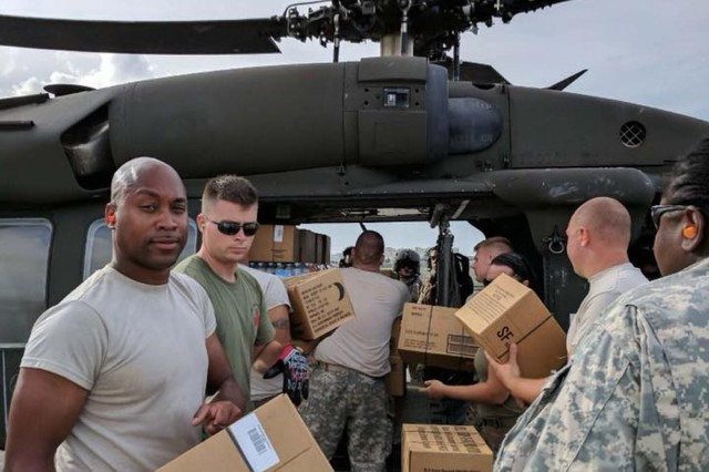 Soldiers of the New York Army National Guard's 3rd Battalion, 142nd Aviation load food and water onto a UH-60 prior to a relief supply delivery mission in Puerto Rico on Oct. 17, 20179.The 3rd Battalion 142nd Aviation has deployed 60 Army National Guard Soldiers and four UH-60 Black Hawk helicopters to Puerto Rico to assist in the island's recovery from Hurricane Maria.