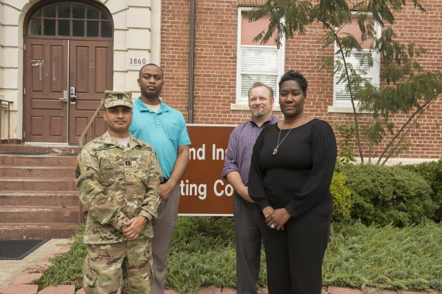 MICC-Fort Bragg contracting officer Nicole Jones, right, credits much of her success to her co-workers, including, from left, Capt. Safiul Alam and Shondell Jordan, tenant contract specialists, and Michael Pressley, Tenant Division chief.