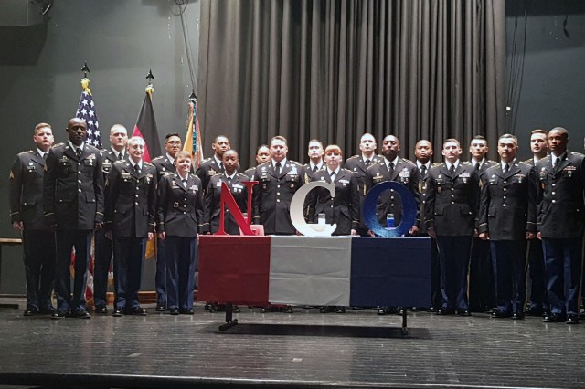 New U.S. Army noncommissioned officers assigned to 2nd Theater Signal Brigade stand on stage for a photo following an NCO induction ceremony Nov. 9, 2017 in Ramstein, Germany.