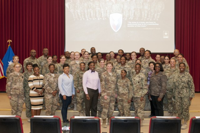 U.S. Air Force Brig. Gen. Leah Lauderback and attendees of a Sisters in Arms forum pose for a photo Oct. 25, 2017, at the Zone 1 Chapel. The forum allowed female leaders to speak to junior service women about mentorship opportunities and accomplishing goals. (U.S. Army photo by Spc. Joseph Black, USARCENT PAO)