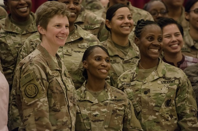 U.S. Air Force Brig. Gen. Leah Lauderback, Col. Carmelia Scott-Skillern and Lt. Col. Donna Sims pose for a photo with other attendees during a Sisters in Arms forum Oct. 25, 2017, at the Zone 1 Chapel. The forum allowed female leaders to speak to junior service women about mentorship opportunities and accomplishing goals. (U.S. Army photo by Justin Graff, 401st Army Field Support Brigade PAO)