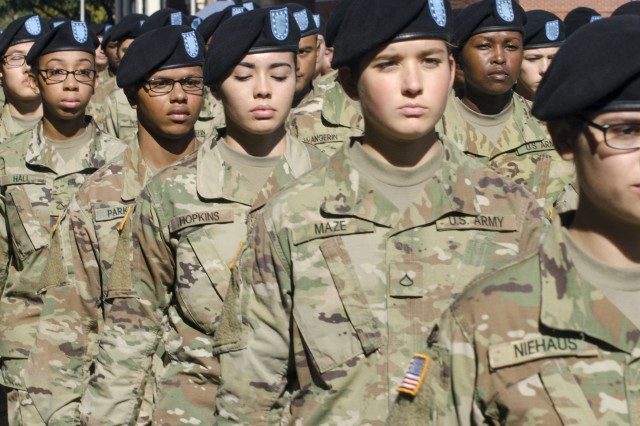 Soldiers from Fort Jackson march down the streets of Columbia, S.C., Nov. 10 during the city's Veterans Day parade. People lined both sides of the street to get a glimpse of the Soldiers led by Maj. Gen. Pete Johnson, Fort Jackson commander marching down the street.