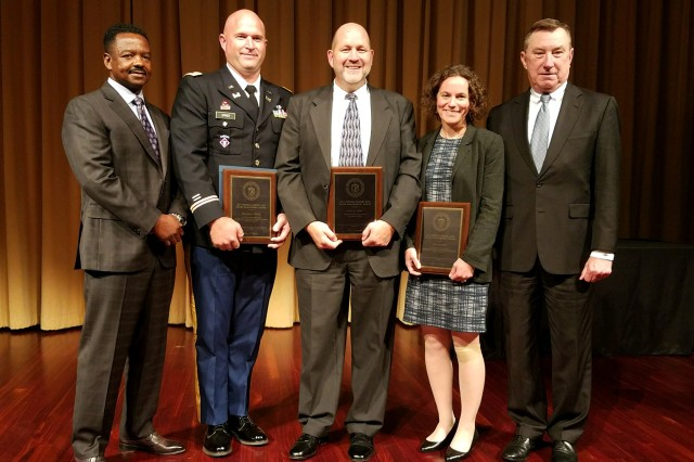 Left to Right: Freddy Poole (Deputy Director of Army Reserve Installation Management Directorate), First Lieutenant Benjamin Spiker (Facility Manager at Kaoru Moto Army Reserve Center), Paul Wirt (Chief of Army Reserve Sustainability Programs), Amy Solana (Army Reserve Net Zero Program Coordinator, Pacific Northwest National Laboratory), and Robert Maxwell (Chief Financial Officer and Director of Resource Management and Materiel, Office of the Chief of the Army Reserve) accept the Federal Energy Management Program awards for the Army Reserve on November 2, 2017 in Washington, D.C.