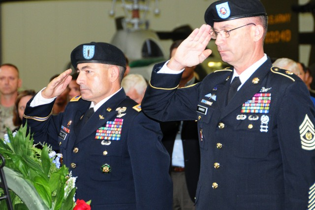 CW5 Joseph B. Roland, chief warrant officer of the Aviation Branch, and Command Sgt. Maj. Gregory M. Chambers, command sergeant major of the Aviation Branch, lay a wreath and salute during a Veterans Day ceremony at the U.S. Army Aviation Museum Nov. 9 in honor of those who have served and sacrificed.