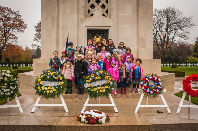Scouts from across Belgium honor veterans in Waregem, a city located in the heart of Flanders Fields, Nov. 11, 2017, at the eleventh hour, during the 99th anniversary of the end of World War I.  The scouts and their family members were among the 200 guests who attended the ceremony.