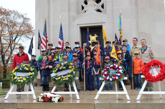 The cub scouts pay tribute to veterans by laying wreaths and reading poems in both English and Flemish in Waregem, a city located in Flanders Fields, Belgium, Nov. 11, 2017, at the eleventh hour, during the 99th anniversary of the end of  World War I. Cub scouts learned about veterans' heroic acts during some of the most intense fighting in the war.