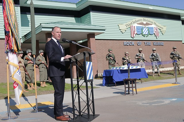 Charles Bowery Jr., executive director, Center of Military History, speaks to a crowd of Soldiers, retirees and civilians during a grand opening ceremony to reveal the 3rd Infantry Division Museum Nov. 16, 2017, at Fort Stewart, Georgia. Bowery said November 2017 had the unique influence of former milestones to help tell the 3rd ID story as it is the month of Marne Week, the Division's centennial, the World War I centennial and the grand reopening of the Marne Museum.(U.S. Army photo by Spc. Noelle Wiehe, 50th Public Affairs Detachment, 3rd Infantry Division/ Released)