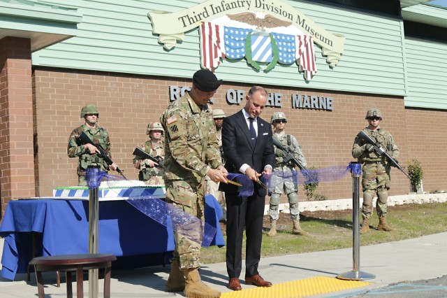 Col. Sean Bernabe, Task Force Marne commander, and Charles Bowery Jr., executive director, Center of Military History, cut the ribbon to reveal the 3rd Infantry Division Museum Nov. 16, 2017, at Fort Stewart, Georgia, during the grand opening ceremony. The museum celebrates and captures the accomplishments of the Marne Division over the last century. (U.S. Army photo by Spc. Noelle Wiehe, 50th Public Affairs Detachment, 3rd Infantry Division/ Released)