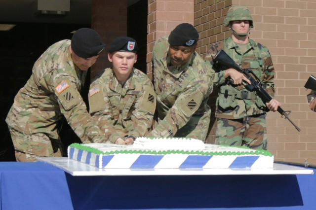 Pvt. Taylor McGough, 1st Battalion, 9th Field Artillery Regiment - the youngest Marne Soldier at 17-years old - cuts the 3rd Infantry Division's 100-year birthday cake at the grand opening ceremony of the 3rd Infantry Division Museum along with Col. Sean Bernabe, Task Force Marne commander, and Command Sgt. Maj. John Johnson Nov. 16, 2017, at Fort Stewart, Georgia. The 3rd Infantry Division birthday was celebrated with the annual Marne Week, during which Dogface Soldiers and leaders participated in sports, events and ceremonies celebrating the 3rd ID. (U.S. Army photo by Spc. Noelle Wiehe, 50th Public Affairs Detachment, 3rd Infantry Division/ Released)