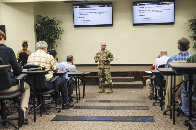 Col. Joel Warhurst speaks to the Anniston Army Depot workforce in a town hall meeting broadcast live from the training office.