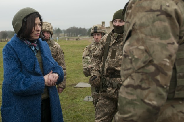 Oksana Syroyid, Vice Speaker of the Ukrainian parliament, known as the Verkhovna Rada of Ukraine, talks with Ukrainian soldiers at the Yavoriv Combat Training Center on the International Peacekeeping and Security Center in Western Ukraine on Nov. 13. (Photo by Capt. Kayla Christopher, 45th Infantry Brigade Combat Team)