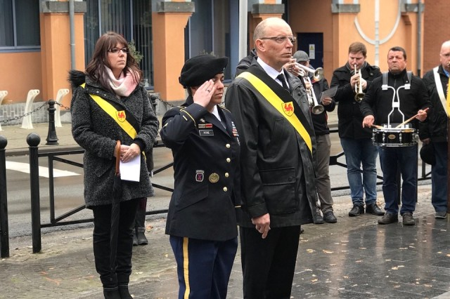 Command Sgt. Maj. Samara Pitre, command sergeant major for  U.S. Army Garrison Benelux, pays her respects to war veterans during an Armistice Day ceremony Nov. 11, 2017, in Chièvres, Belgium.