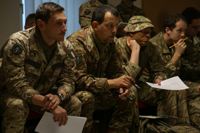 Soldiers of the 24th Italian Artillery Regiment, Lithuania Griffin Brigade, and the Royal Regiment of Fusiliers participate in a mission brief during exercise Allied Spirit VII at the U.S. Army's Joint Multinational Readiness Center in Hohenfels, Germany, Nov. 9, 2017. Approximately 4,050 service members from 13 nations are participating in exercise Allied Spirit VII at 7th Army Training Command's Hohenfels Training Area, Germany, Oct. 30 to Nov. 22, 2017. Allied Spirit is a U.S. Army Europe-directed, 7ATC-conducted multinational exercise series designed to develop and enhance NATO and key partners' interoperability and readiness.