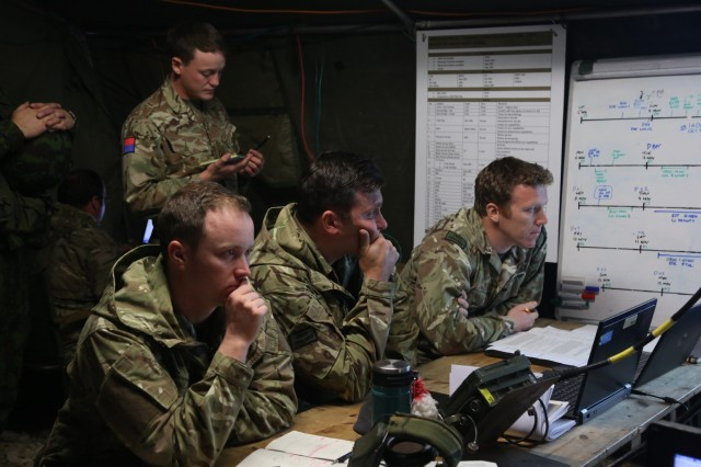 British soldiers of the 1st Battalion, Royal Regiment of Fusiliers receive mission details while conducting a back brief during exercise Allied Spirit VII at the U.S. Army's Joint Multinational Readiness Center in Hohenfels, Germany, Nov. 5, 2017. Approximately 4,050 service members from 13 nations are participating in exercise Allied Spirit VII at 7th Army Training Command's Hohenfels Training Area, Germany, Oct. 30 to Nov. 22, 2017. Allied Spirit is a U.S. Army Europe-directed, 7ATC-conducted multinational exercise series designed to develop and enhance NATO and key partners' interoperability and readiness.