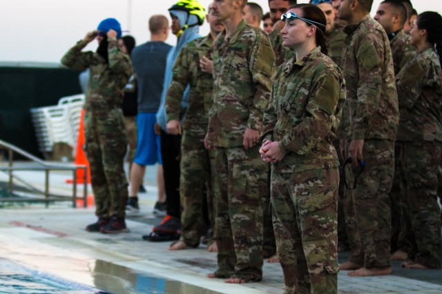 Camp Arifjan, Kuwait (Nov. 16, 2017) - Coalition forces stationed at Camp Arifjan cheer on participants swimming in the first event for the German Armed Forces Proficiency Badge. Participants had to swim 100 meters in under four minutes in uniform and undress submerged afterwards in order to continue to the next event. The GAFPB was hosted by the 1st Theater Sustainment Command - OCP, the next event is the basic fitness test. (U.S. Army photos by Sgt. Jaccob Hearn)