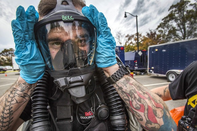 U.S. Army Survey Team member Sgt. Joseph A. Bercovic of the New Jersey National Guard, adjusts his breathing apparatus during an Army North mandated training proficiency evaluation at the Veterans Affairs Medical Center-Lyons, Lyons, N.J., Oct. 25, 2017. The 21st WMD-CST's mission is to support civil authorities by identifying chemical, biological, radiological and nuclear substances in either man-made or natural disasters.