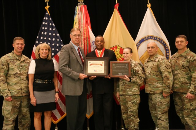 Mr. Joe Capps, IMCOM Chief of Staff, and CSM Melissa Judkins presented the Stalwart award to Kario D. Harris of IMCOM-Pacific.