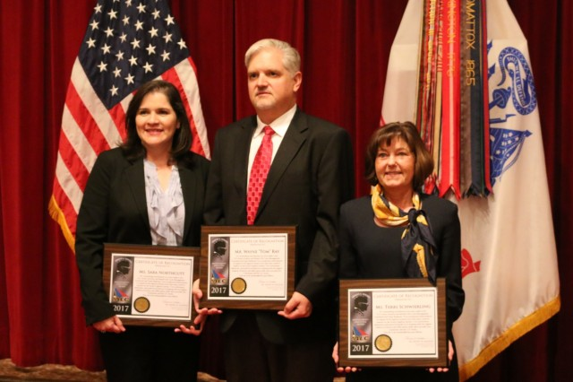 "Aviation and Missile Command employees, from left, Sara Northcutt, Wayne ""Tom"" Ray and Terri Schwierling are recognized as the nominees in the Management/Executive category of the Ernest A. Young Logistics Achievement Award at a Nov. 23 luncheon at Redstone Arsenal's Summit."