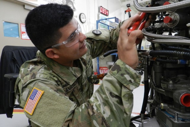 Private 1st Class Randall Amayadiaz, with the Utah National Guard, puts a locking tab on a T55 at Corpus Christi Army Depot's engine shop where he can focus his practice maintaining CH-47 engines, Nov. 9, 2017. He is one of a handful of Soldiers from D Company, 2-211th General Support Aviation Battalion, who sought an opportunity to handle this high-performing helicopter engine that gets its share of use when deployed.