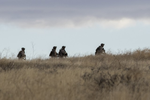 Soldiers with 1-23 Infantry, 1-2 Stryker Brigade Combat Team, approach a mock village Nov. 2, 2017, at Yakima Training Center, Washington, during Operation Argos. This was a training exercise that included company combined arms live fire exercises, a sustainer gunnery and a joint capabilities integration exercise.