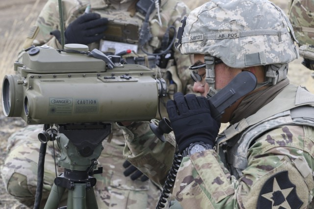 A Soldier with 1-14th Cavalry uses a Laser Designator Rangefinder to determine if artillery destroyed targets during a Joint Capabilities Integration Exercise Nov. 14, 2017, at Yakima Training Center, Washington. This was part of Operation Argos, a training exercise that included company combined arms live fire exercises, a sustainer gunnery and a joint capabilities integration exercise.