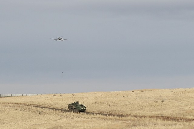 An A-10 Thunderbolt II flies over a Stryker Combat Vehicle as the aircraft approaches an observation point Nov. 14, 2017, at Yakima Training Center, Washington. This was part of Operation Argos, a training exercise that included company combined arms live fire exercises, a sustainer gunnery and a joint capabilities integration exercise.