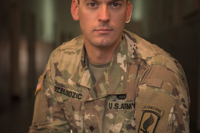 PANCEVO, Serbia -- U.S. ARMY Paratrooper Spc. Uros Dzelebdzic, a medic with Charlie Company, 173rd Brigade Support Battalion, 173rd Airborne Brigade, during Exercise Double Eagle on November 15th, 2017. Dzelebdzic was born in Belgrade, Serbia and is acting as translator during the exercise. Exercise Double Eagle is a multi-national company-level airborne insertion exercise designed to enhance the relationship between the U.S. and Serbia and strengthen regional security.