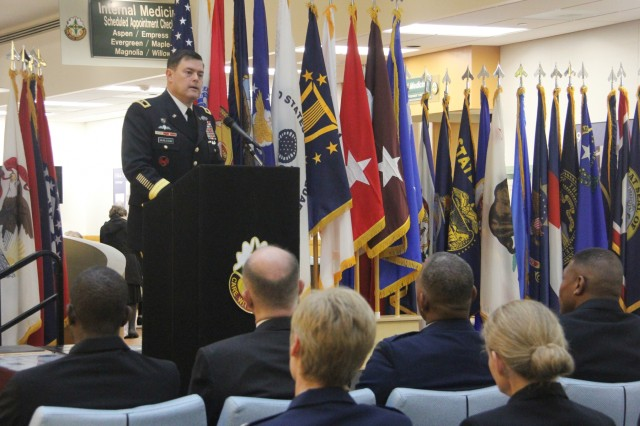 """Army Maj. Gen. Willard M. Burleson III, commanding general, 7th Infantry Division, provides opening remarks during the MHS GENESIS Recognition Ceremony Nov. 15 at Madigan Army Medical Center. The ceremony commemorated the deployment of the Department of Defense's new electronic health record at its four initial fielding sites in the Pacific Northwest - Madigan, Naval Hospital Bremerton, Naval Health Clinic Oak Harbor and Fairchild Air Force Base.""""When you think about where we have Soldiers, Sailors, Airmen, Marines and Coast Guardsmen stationed throughout the world - whether in combat or permanently stationed - the capability that we're introducing with MHS GENESIS going live is tremendous,"""" he said. """"A soldier wounded in a remote location being provided care and treatment, where his medical records, history and transparent care can be provided not only all the way through the continuum of care but even on to the point where they leave the service is absolutely tremendous."""""""