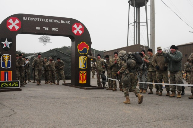 As onlookers cheer, one of the final 20 candidates for 8th Army's 2017 Expert Field Medical Badge rushed towards the finish line of  final the twelve-mile foot march of 8th Army's 2017 Expert Field Medic's at Warrior Base, Republic of Korea, November 11, 2017. One hundred-thirty nine candidates traveled to Warrior Base from across the Korean Peninsula to compete for the badge. (U.S. Army photo by Staff Sgt. Ben Hutto, RELEASED)