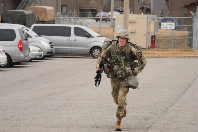 Private First Class Elijah Geesman, a medic assigned to the 2nd Sustainment Brigade,  2nd Infantry Division, ROK/US Combined Division, sprints towards the finish line of 8th Army's 2017 Expert Field Medic's final foot march at Warrior Base, Republic of Korea, November 11, 2017. Geesman was one of 20 finalists that earned his EFMB. (U.S. Army photo by SSG Ben Hutto, RELEASED)