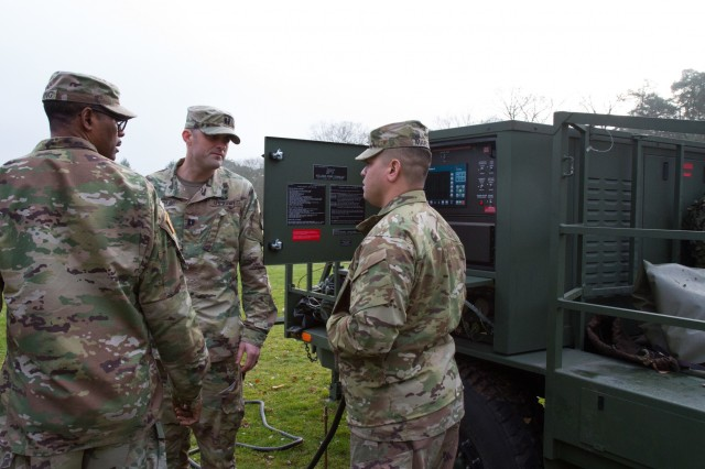 U.S. Army Reserve Capt. Anthony Smith, center, operations officer, speaks with Sgt. 1st Class Marcos Martinez, right, motor sergeant, Headquarters and Headquarters Company, 361st Civil Affairs Brigade, during the setup of a generator as part of a Civil-Military Operations Center (CMOC) expeditionary deployment operations exercise Nov. 18, 2017 in Kaiserslautern, Germany. The purpose of the exercise was to establish and validate communications for a CMOC in austere environments. (U.S. Army Reserve photo by Spc. Daisy Zimmer, 221st Public Affairs Detachment)