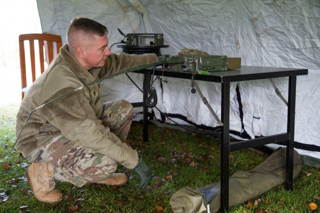 U.S. Army Reserve Staff Sgt. Justin Trekell, radio operator, Headquarters and Headquarters Company, 361st Civil Affairs Brigade, establishes radio communications as part of a Civil-Military Operations Center (CMOC) expeditionary deployment operations exercise Nov. 18, 2017 in Kaiserslautern, Germany. The purpose of the exercise was to establish and validate communications for a CMOC in austere environments. (U.S. Army Reserve photo by Spc. Daisy Zimmer, 221st Public Affairs Detachment)