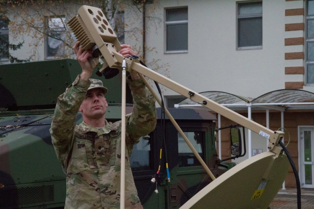 U.S. Army Reserve Spc. Daniel Miller, information technology specialist, Headquarters and Headquarters Company, 361st Civil Affairs Brigade, installs a satellite as part of a Civil-Military Operations Center (CMOC) expeditionary deployment operations exercise Nov. 18, 2017 in Kaiserslautern, Germany. The purpose of the exercise was to establish and validate communications for a CMOC in austere environments. (U.S. Army Reserve photo by Spc. Daisy Zimmer, 221st Public Affairs Detachment)
