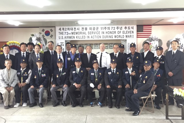 Group photo of participants in the 72 nd memorial service in honor of eleven U.S. Airmen killed in action during World War II, including Mr. Kim, Jong-ki, son of Mr. Kim, Duk-hyung, Lt. Col. George S. Crockatt, and members of the Korean War Veterans' Association.
