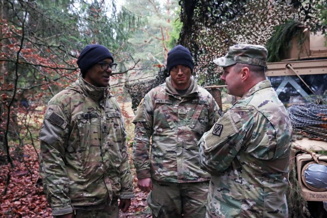 "U.S. Army Command Sgt. Maj. Chad Yeager (far right), the senior enlisted advisor assigned to the 44th Expeditionary Signal Battalion, 2nd Theater Signal Brigade, speaks with Soldiers assigned to Charlie Company, 44th Expeditionary Signal Bn., providing communications support to Lithuania's ""Griffin"" Brigade during exercise Allied Spirit VII, Nov. 15, 2017 in the Hohenfels Training Area, Germany."