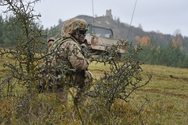 U.S. Army Staff Sgt. Marcin Szewczyk with 1st Squadron, 2nd Cavalry Regiment overlooks the terrain during Exercise Allied Spirit VII at the 7th Army Training Command's Hohenfels Training Area, Germany, Nov. 16, 2017. Approximately 4,050 service members from 13 nations are participating in the exercise from Oct. 30 to Nov. 22, 2017. Allied Spirit is a U.S. Army Europe-directed, 7ATC-conducted multinational exercise series designed to develop and enhance NATO and key partners' interoperability and readiness.