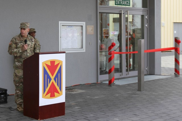 "RHINE ORDNANCE BARRACKS, Germany - Special guest speaker Col. David E. Shank, commander of the 10th AAMDC, said a few words during the Defender Café ribbon cutting ceremony Nov. 20. ""This is a big day,"" Shank said. ""It took us over two years to move about 400 meters,"" Shank said. ""Construction began in 2015, and today is that day that we will cut that ribbon and will officially open the Defender Café."" (Photo by Robert Durr, 10th AAMDC PAO)"