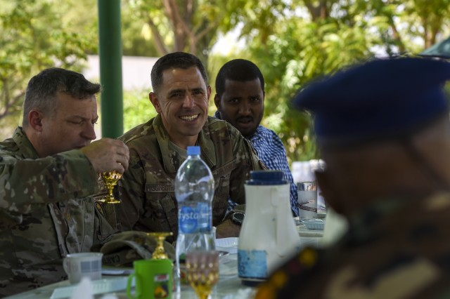 U.S. Air Force Chief Master Sgt. Benjamin Higginbotham, Combined Joint Task Force - Horn of Africa command senior enlisted leader, listens to Djibouti Armed Forces (FAD) Lt. Col. A. Omar during a visit to the FAD military training center at Holhol, Djibouti, Nov. 14, 2017. Higginbotham accompanied leaders of the Kentucky National Guard as they visited their FAD partners. The Kentucky National Guard and the FAD are partners through the State Partnership Program.