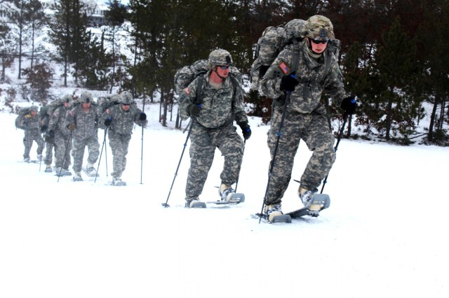 Soldiers with the 181st Multi-Functional Training Brigade participate in a snowshoe-skills training session at Training Area D-10 on Jan. 26, 2017, as part of the first Cold-Weather Operations Course at Fort McCoy, Wis. The course was a proof-of-principle training event by the Directorate of Plans, Training, Mobilization and Security designed to teach junior leaders - such as noncommissioned officers and junior officers - to utilize the Army's cold-weather equipment. (U.S. Army Photo by Scott T. Sturkol, Public Affairs Office, Fort McCoy, Wis.)