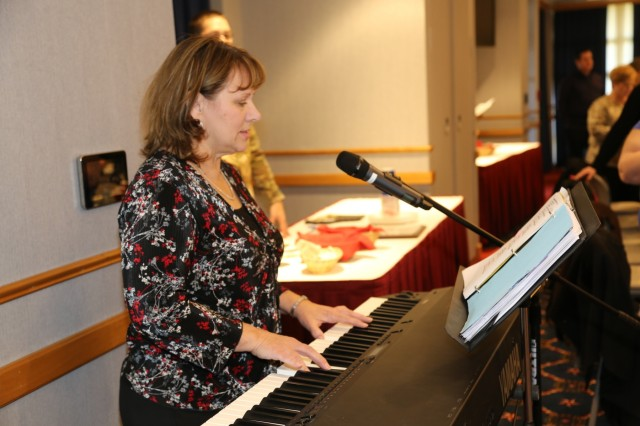 Retired Fort McCoy employee Karen Birkeness plays a song selection during the Veterans Day Prayer Luncheon on Nov. 9, 2017, at Fort McCoy, Wis. Dozens of people from the Fort McCoy community attended the annual event to honor military veterans. (U.S. Army Photo by Scott T. Sturkol, Public Affairs Office, Fort McCoy, Wis.)