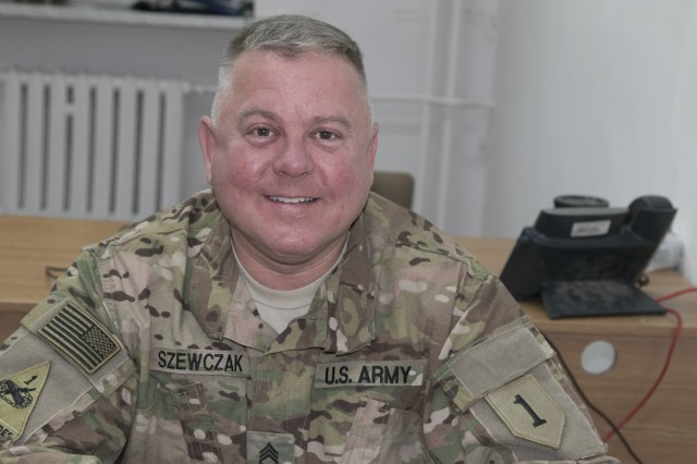 "Sgt. 1st Class John Szewczak, a chemical, biological, radiological and nuclear specialist with Headquarters and Headquarters Company, 2nd Armored Brigade Combat Team, 1st Infantry Division out of Fort Riley, Kansas, works from his office in Poland, Nov. 18, 2017. Szewczak is among the Dagger Brigade's ""heel-to-toe"" rotation of U.S. Soldiers ready to train with allied and partnered nations to demonstrate combat proficiencies and capabilities during Atlantic Resolve exercises across Central Europe."