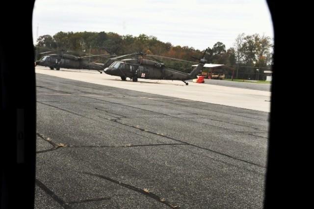 Two Black Hawks are seen outside as the flight begins.