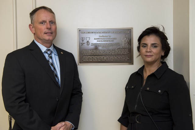 Jim and Jovanna Nelson stand outside of the Brenden Salazar-Nelson Operations Center at ARL headquarters in Adelphi, Maryland.