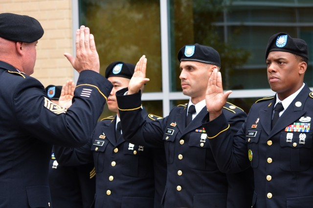 Carl R. Darnall Army Medical Center's Command Sgt. Maj. Gary Williams administers the Army's Non-Commissioned Officer charge to the hospital's newly appointed NCOs during the Nov. 15 induction ceremony at the Fort Hood hospital.
