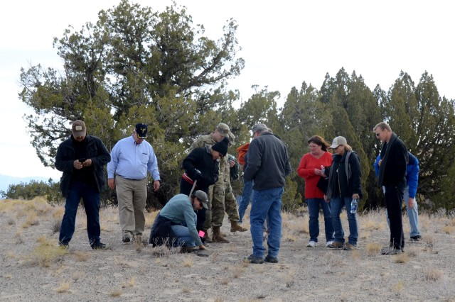 More than 40 people hiked to an archeological site at Dugway Proving Ground Nov. 6. Rachel Quist, the Garrison's cultural resource manager, organized the event and said it was important to identify and mark these artifact sites because it preserves the history and the culture of the hunter-gatherers of the Bonneville Basin. Photo by Bonnie A. Robinson, Dugway Proving Ground Public Affairs