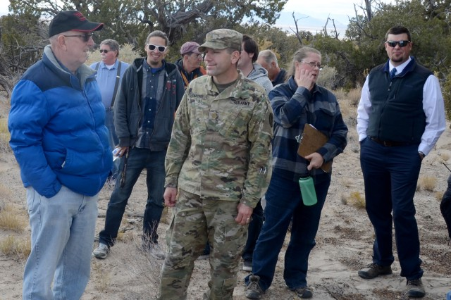 The Native American Tour, Nov. 6, offered some of the best evidence of the hunter-gathers who lived within the borders of Dugway Proving Ground 7,000 years ago. Pictured (L to R) are Gary Millar, deputy chief of the Test Support Division; Bob Abston, Supervisor of the Range and Airfield Office; Maj. Brandon Garner, commander of the Dugway Health Clinic; Rachael Quist, cultural resource manager of the Environmental Program office and Garrison Manager Aaron Goodman. Photo by Bonnie A. Robinson, Dugway Proving Ground Public Affairs
