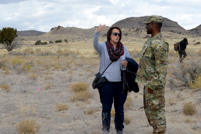 "Janine Hoskins and Command Sgt. Major Joe Bonds discuss the archeological site during a Native American Heritage Month tour Nov. 6 near the Cedar Mountain Range.  Hoskins called the site ""Amazing"" and commended the Army's stewardship in protecting this legacy site. Photo by Bonnie A. Robinson, Dugway Proving Ground Public Affairs"