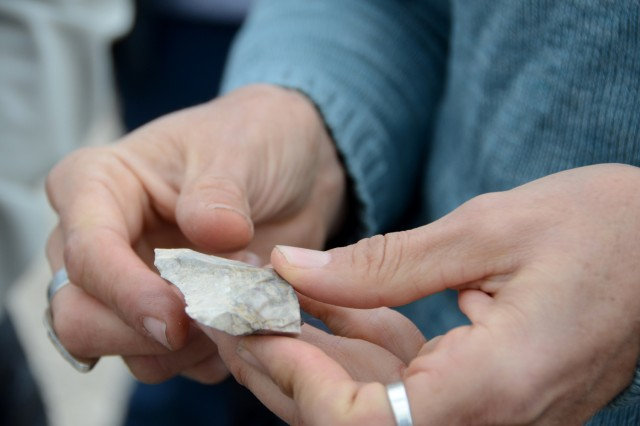 The Dugway tour allowed attendees to examine smaller chipped stones that were likely broken spear points used by hunters to attach to sticks and uses as handheld spears for smaller game or reptiles. Photo by Bonnie A. Robinson, Dugway Proving Ground Public Affairs